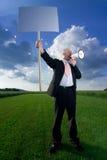 Homme avec le signe et le mégaphone Photos libres de droits