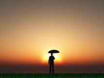 Homme avec le soleil de parapluie Photo stock