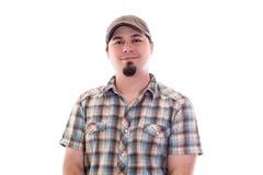 Homme avec le sourire de chemise de chapeau et de plaid de conducteur Photo libre de droits