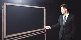 Homme avec le tableau noir vide Photographie stock