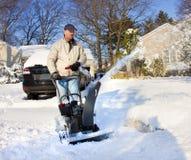 Homme avec le ventilateur de neige Image stock