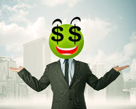 Homme avec le visage de smiley de symbole dollar Photo stock