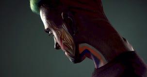 Homme avec le visage squelettique coloré montrant le sourire mauvais banque de vidéos