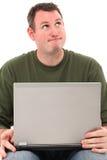 Homme avec penser d'ordinateur portatif Images stock