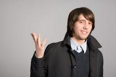 Homme avec sa main augmentée Photo libre de droits