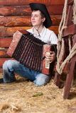 Homme avec un accordéon image libre de droits
