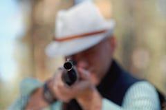 Homme avec un canon Photographie stock libre de droits