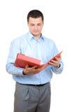 Homme avec un dépliant rouge photographie stock libre de droits