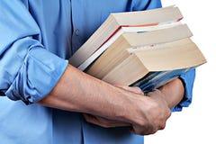 Homme avec un livre Photos stock