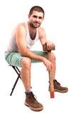 Homme avec un marteau Photographie stock libre de droits