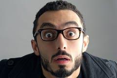 Homme avec une expression du visage étonnée Image libre de droits