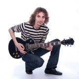 Homme avec une guitare Images stock