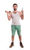 Homme avec une hache et un marteau Images stock