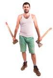 Homme avec une hache et un marteau Photo stock