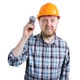 Homme avec une lampe-torche photo stock