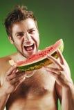 Homme avec une pastèque Image libre de droits
