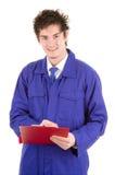 Homme avec une planchette image libre de droits