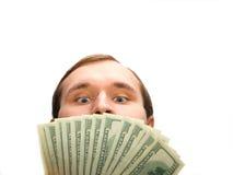 Homme avide avec l'argent Photographie stock libre de droits