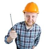 Homme barbu dans un casque avec le tournevis images libres de droits