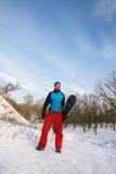 Homme barbu de sourire avec le surf des neiges Images libres de droits