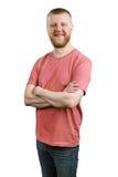 Homme barbu heureux dans une chemise et des jeans photo libre de droits