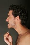 Homme bel avec des brucelles Photo libre de droits