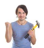 Homme bel avec le marteau. D'isolement sur le blanc Images stock