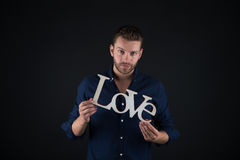 Homme bel avec le texte d'amour Image libre de droits