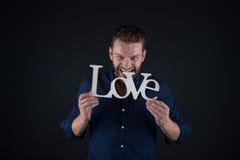 Homme bel avec le texte d'amour Photo stock