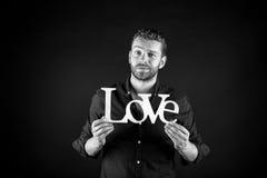 Homme bel avec le texte d'amour Photographie stock libre de droits