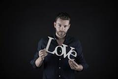 Homme bel avec le texte d'amour Images stock