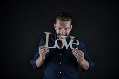 Homme bel avec le texte d'amour Photos stock