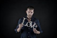 Homme bel avec le texte d'amour Photographie stock