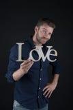 Homme bel avec le texte d'amour Images libres de droits