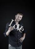 Homme bel avec le texte d'amour Photo libre de droits