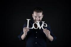 Homme bel avec le texte d'amour Image stock