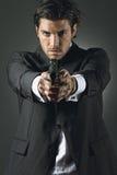 Homme bel avec une arme à feu Images libres de droits