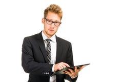 Homme bel d'affaires avec la tablette Photo libre de droits