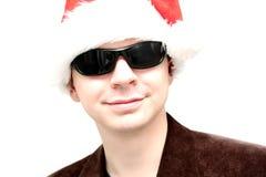 Homme bel dans le chapeau de Santa Photo stock