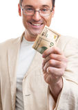 Homme bel donnant quelques dollars Image stock