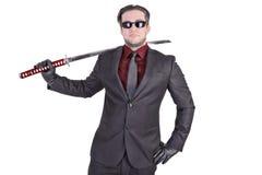 Homme bel tenant l'épée de katana Photographie stock libre de droits