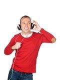 Homme bien disposé avec l'écouteur Photos stock