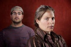 Homme bouleversé et femme coupable Photos stock