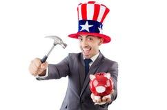 Homme cassant la banque avec le marteau Image stock
