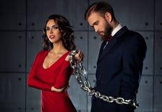 Homme catched par femme Photographie stock libre de droits
