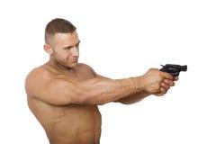 Homme caucasien musculaire avec l'arme à feu photographie stock