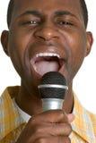 Homme chanteur Photographie stock