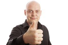 Homme chauve dans le pouce de chemise vers le haut Photo libre de droits
