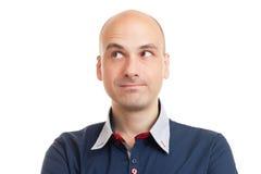 Homme chauve de pensée regardant le copyspace Photographie stock libre de droits