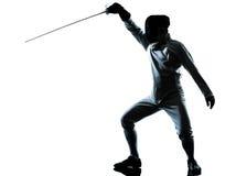 Homme clôturant la silhouette Photographie stock libre de droits